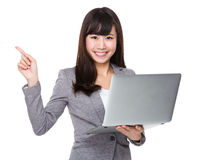 Businesswoman use of the laptop computer and finger point up Royalty Free Stock Photos