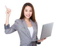 Businesswoman use of laptop computer and finger up Stock Photos