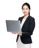 Businesswoman use laptop computer stock photography