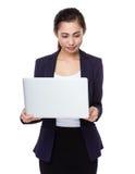 Businesswoman use of laptop computer Stock Photos