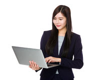 Businesswoman use of laptop computer Stock Images