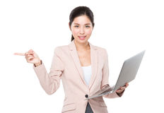 Businesswoman use of laptop and finger point aside Stock Photos