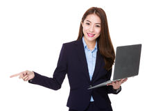 Businesswoman use of laptop and finger point aside Royalty Free Stock Photo