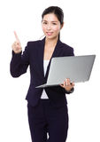Businesswoman use of laptop and finger point up Stock Photos