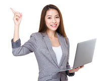 Businesswoman use of laptop and finger point up Royalty Free Stock Photography