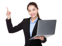 Businesswoman use of laptop and finger point up Stock Images