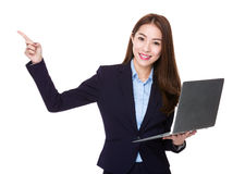 Businesswoman use of laptop and finger point up Royalty Free Stock Images