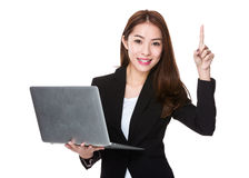 Businesswoman use of laptop and finger point up Royalty Free Stock Photo