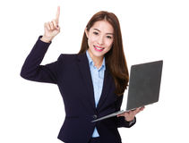 Businesswoman use of laptop and finger point up Stock Photography