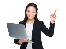 Businesswoman use of laptop and finger up Royalty Free Stock Photo