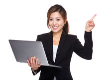 Businesswoman use of laptop and finger up Stock Images