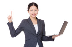 Businesswoman use of laptop and finger up Stock Photography