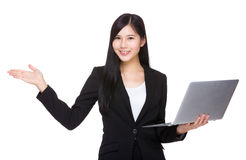 Businesswoman use of laptop and open hand palm Stock Image