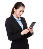 Businesswoman use of mobile phone Stock Photo