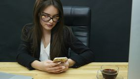Businesswoman use mobile phone in office.  stock video