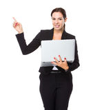 Businesswoman use of notebook computer and finger point up Stock Photo