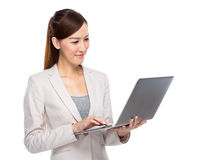 Businesswoman use notebook computer Stock Photos