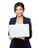 Businesswoman use of notebook computer Stock Photo