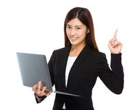 Businesswoman use notebook and finger up Stock Image