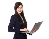 Businesswoman use of notebook Stock Image