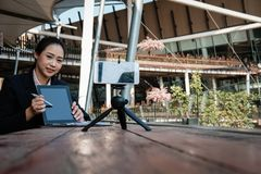 Businesswoman use smartphone for online live streaming. woman re. Asian businesswoman use smartphone for online live streaming. woman recording video blog Stock Photo