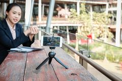 Businesswoman use smartphone for online live streaming. woman re. Asian businesswoman use smartphone for online live streaming. woman recording video blog Stock Images