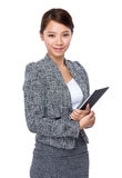 Businesswoman use of tablet Stock Photos