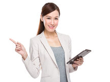 Businesswoman use tablet and finger point up Stock Image