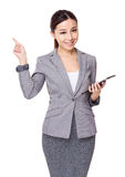 Businesswoman use of tablet and finger point up Stock Image