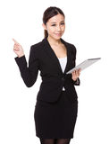Businesswoman use of tablet and finger point up Royalty Free Stock Photos