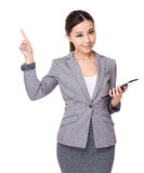 Businesswoman use of tablet and finger point up Royalty Free Stock Photography