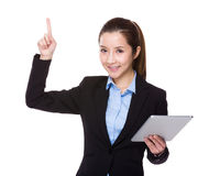 Businesswoman use of tablet and finger point up Stock Photos