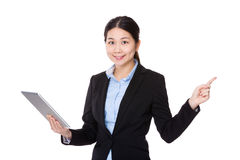 Businesswoman use of tablet and finger point up Stock Photo