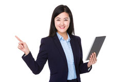 Businesswoman use of tablet and finger point up Royalty Free Stock Photo