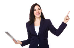 Businesswoman use of tablet and finger point up Royalty Free Stock Images
