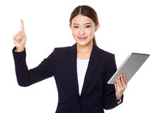 Businesswoman use of tablet and finger point up Stock Photography