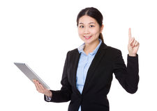 Businesswoman use of tablet and finger up Royalty Free Stock Photography