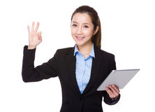 Businesswoman use of tablet and ok sign Stock Photography