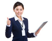 Businesswoman use tablet and thumb up Stock Images