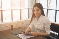 Businesswoman use tablet to analyze market chart at workplace. y Stock Photos