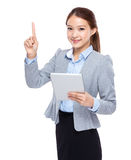 Businesswoman use of tableta and finger point up Royalty Free Stock Images