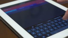 Businesswoman uses a digital tablet. Closeup. Businesswoman uses a digital tablet for internet and email stock footage