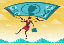 Businesswoman uses her Financial Dollar Bill Parachute. Stock Photos