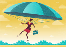 Businesswoman uses her Parachute. Stock Images