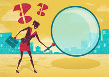 Businesswoman uses magnifying glass to find clues. Stock Photography