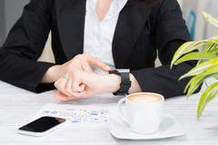 Businesswoman uses smart watch and phone. Smartwatch concept Stock Photo