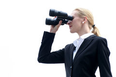 Businesswoman using binoculars Royalty Free Stock Images