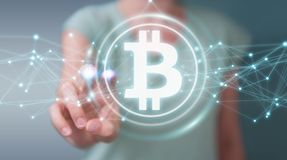 Businesswoman using bitcoins cryptocurrency 3D rendering. Businesswoman on blurred background using bitcoins cryptocurrency 3D rendering Royalty Free Stock Photos