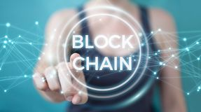 Businesswoman using blockchain cryptocurrency interface 3D rende. Businesswoman on blurred background using blockchain cryptocurrency interface 3D rendering Stock Photography