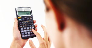 Businesswoman using calculator. Against white background 4k stock video footage
